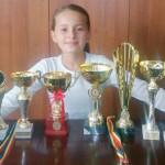 TENIS: Evelyn Neacşu, de la CS Târgovişte, a câştigat două turnee în l...