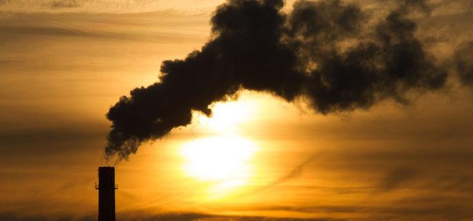 Smoking chimneys at sunset